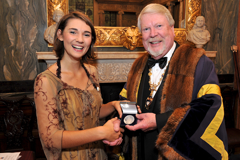 John presents Claire Iselin (Trinity Laban Conservatoire) with the Musicians' Company Silver Medal at Drapers' Hall (November 2012)
