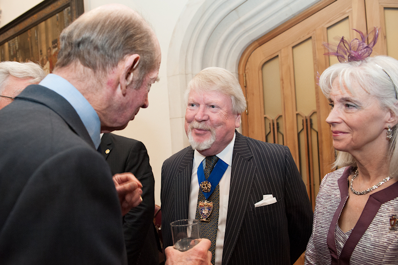 At London's Guildhall in 2013 HRH The Duke of Kent enquires about the symbolism on John's Livery regalia, as Marie looks on