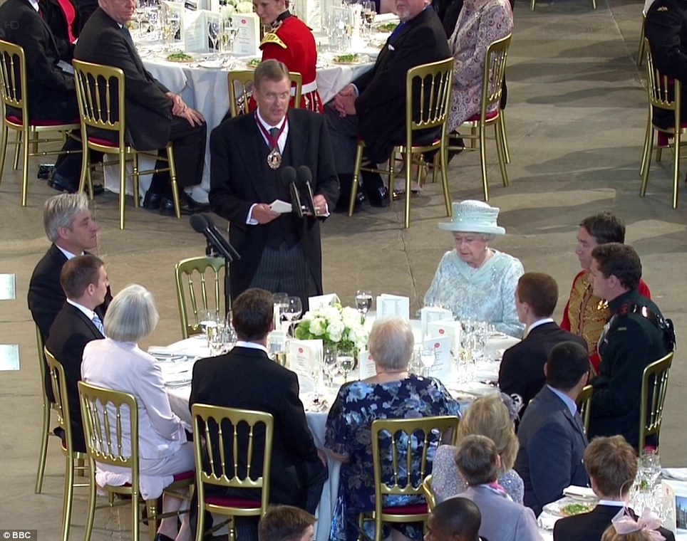 At The Queen's Diamond Jubilee Lunch at the Palace of Westminster (June 2012) representatives of the Musicians' Company (top background) are placed at the table next to Her Majesty the Queen. (l-r: Professor Barry Ife, Musician Natalie White (Band of the Welsh Guards), Professor John Morehen)